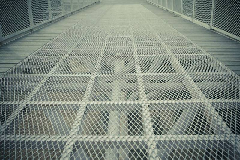Expanded metal mesh with diamond holes and raised surface is used as flooring.