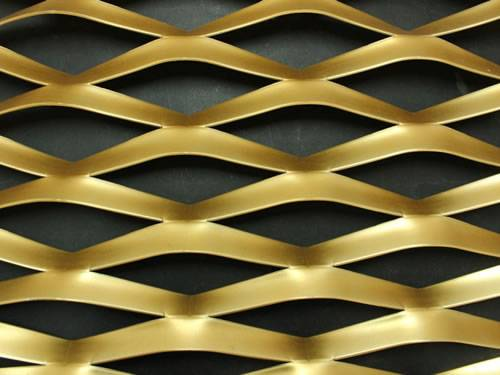 Raised expanded brass mesh details with diamond holes.