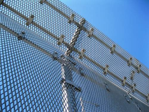 Raised expanded metal panels with diamond holes and bending top are used as security fence.
