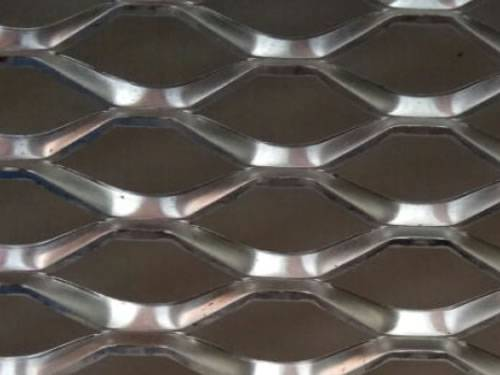 Stainless steel expanded metal details with raised surface and hexagonal holes.