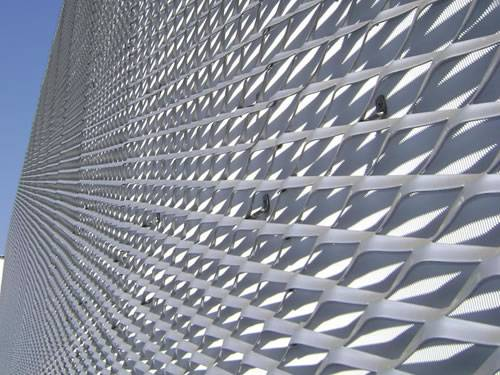 Galvanized expanded metal sheet with raised surface and diamond holes is used as facade.