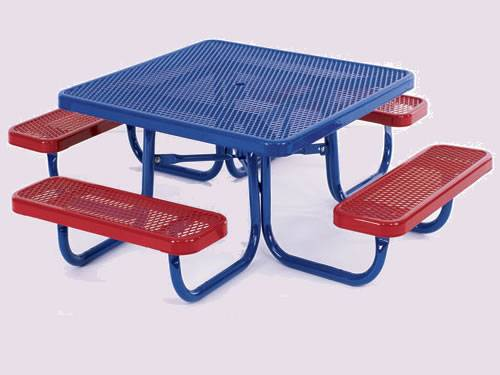There is one set of garden furniture with four red benches and one blue table.