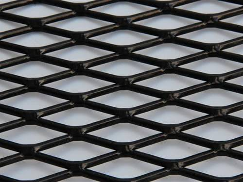 Raised expanded metal steel sheet details with black surface and diamond holes.