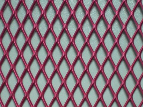 Red expanded metal mesh details with raised surface and diamond holes.