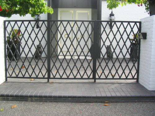 Expanded metal gate made of three expanded metal meshes with black surface and diamond holes in the villa.